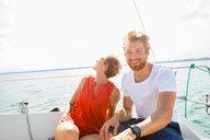 Young man and mature woman sailing on Chiemsee lake, Bavaria, Germany - CUF49602