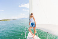 Young woman on sailboat on Chiemsee lake, portrait, Bavaria, Germany - CUF49605