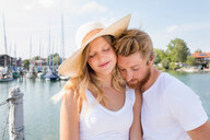 Romantic young couple on sailboat on Chiemsee lakeside, Bavaria, Germany - CUF49632