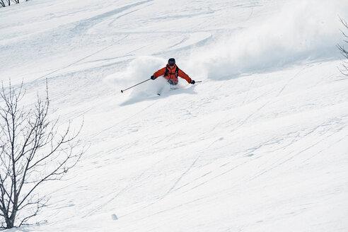 Male skier skiing down mountain, Alpe-d'Huez, Rhone-Alpes, France - CUF49683