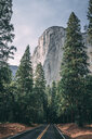Diminishing perspective of empty road against mountain at Yosemite National Park - CAVF63136