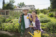Smiling father and daughter in vegetable garden - HEROF28428
