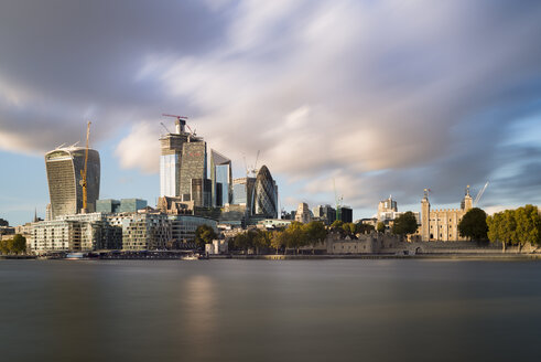 UK, London, City of London, River Thames, skyline with modern office buildings and Tower of London - MKFF00443
