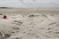 Netherlands, Schiermonnikoog, beach toys in sand on lonely beach - DWF00348