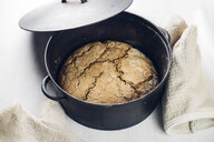Baked sourdough bread in a iron-cast pot - IPF00514
