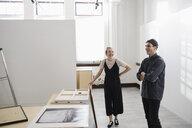Art gallery owners hanging art - HEROF28646