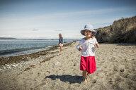 Cute girl in sunhat on beach, portrait, Port Townsend, Washington, USA - CUF49743