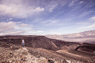 Man looking out over bleak arid landscape, Death Valley Junction, California, USA - CUF49800
