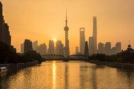 Golden sunset over Waibaidu Bridge and Pudong skyline, Shanghai, China - CUF49827