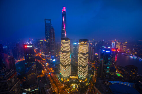 Pudong skyline with Shanghai Tower, Shanghai World Financial Centre and IFC  at night, high angle view, Shanghai, China - CUF49830