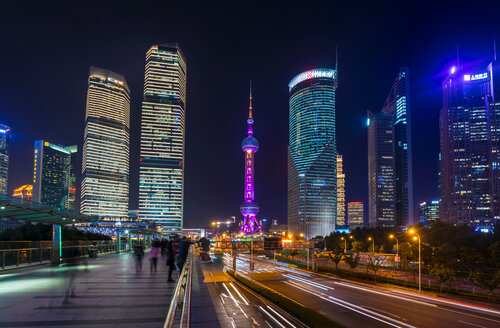Pudong skyline and Oriental Pearl Tower from elevated walkway at night, Shanghai, China - CUF49848