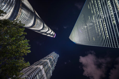 Jin Mao Tower, Shanghai Tower, Shanghai World Financial Centre at night, low angle view, Shanghai, China - CUF49851