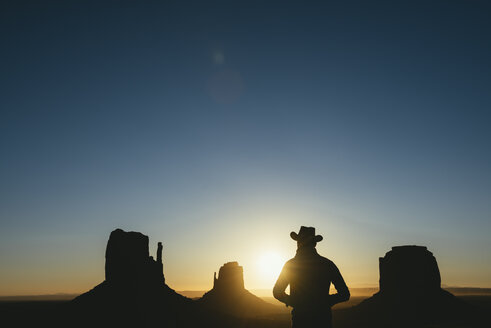 USA, Utah, Monument Valley, silhouette of man with cowboy hat  watching sunrise - GEMF02893