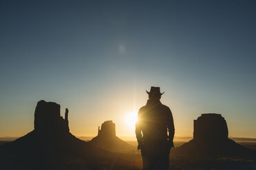 USA, Utah, Monument Valley, silhouette of man with cowboy hat  watching sunrise - GEMF02896