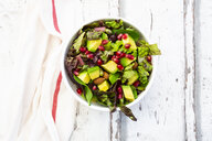 Detox salad bowl with avocado, pomegranate seeds, roasted soybeans, sunflower seeds and nuts - LVF07868
