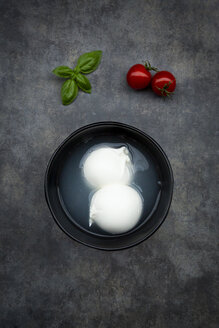 Tomatoes, basil leaves and burrata in bowl, from above - LVF07871
