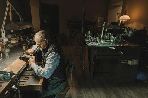 Artisan making jewellery in his workshop - AHSF00011