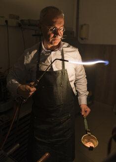 Artisan making jewellery in his workshop - AHSF00029