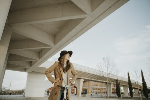 Young hipster woman with a bicycle - AHSF00067