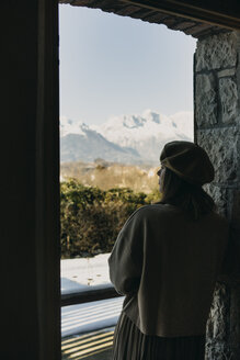 Italy, Limana, back view of woman looking at distance - ALBF00829
