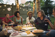 Friends enjoying backyard birthday party - HEROF28843