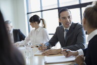 Business people talking in conference room meeting - HEROF28927
