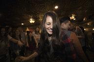 Smiling woman dancing at party - HEROF28984