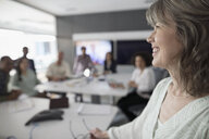 Smiling businesswoman leading conference room meeting - HEROF29158