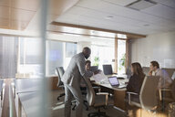 Businessman leading conference room meeting - HEROF29254