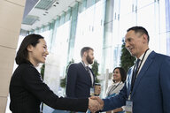 Business people handshaking, networking at conference - HEROF29293