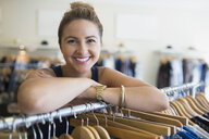 Portrait smiling woman in clothing shop - HEROF29438
