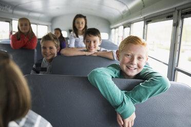 Portrait confident school kids on school bus - HEROF29651