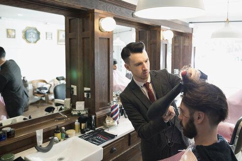 Barber blow drying man - HEROF29728
