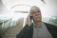 Smiling senior man mustache talking on cell phone - HEROF29789