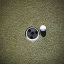 Golf Ball Next to a Putting Cup - MINF10874