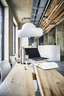 Creative office with cloud balloon and laptop - FMKF05437