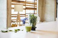 Green smoothie on table in office - FMKF05458