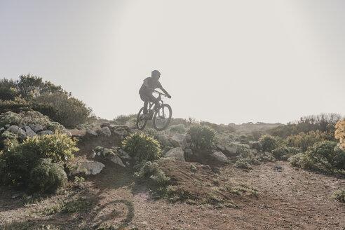 Spain, Lanzarote, mountainbiker on a trip in desertic landscape - AHSF00086