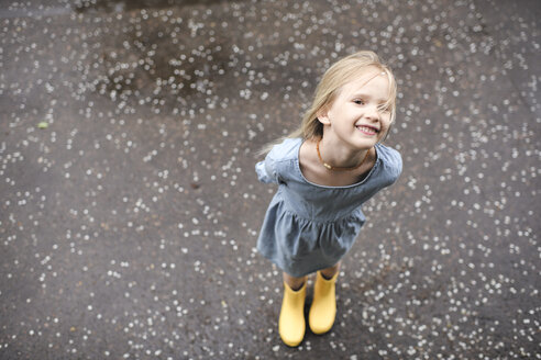 Girl wearing blue dress and rubber boots - EYAF00003