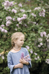 Portrait of smiling girl with lilac blossoms - EYAF00009