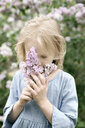 Portrait of smiling girl with lilac blossoms, sniffing - EYAF00012