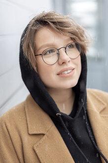 Portrait of young woman at snowfall - VGF00247