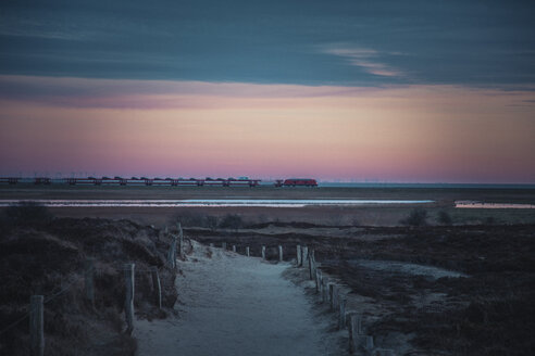 Germany, Sylt, Schleswig-Holstein Wadden Sea National Park, Morsum Kliff, dune landscape, car carrying train, evening light - ANHF00083