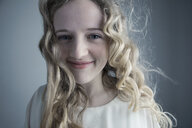 Close up portrait smiling Caucasian young woman with messy curly blonde hair - HEROF29981