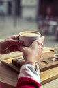 Woman's hands holding cup of coffee, close-up - ACPF00492