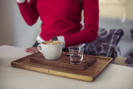 Cup of coffee and glass of water in a coffee shop - ACPF00495