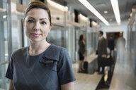 Portrait confident, serious female attorney in courthouse corridor - HEROF30100