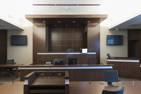 Empty wood paneled courtroom and judge bench - HEROF30129