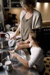 High angle view of mother and daughter working in kitchen at home - MASF11601
