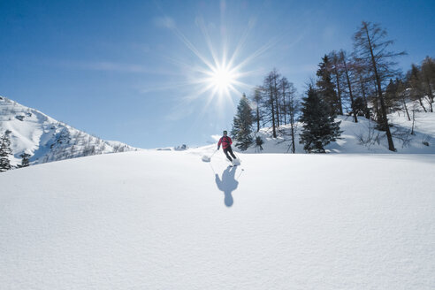 Germany, Bavaria, Berchtesgaden, Jenner, Backcountry skiing against the sun - HAMF00573